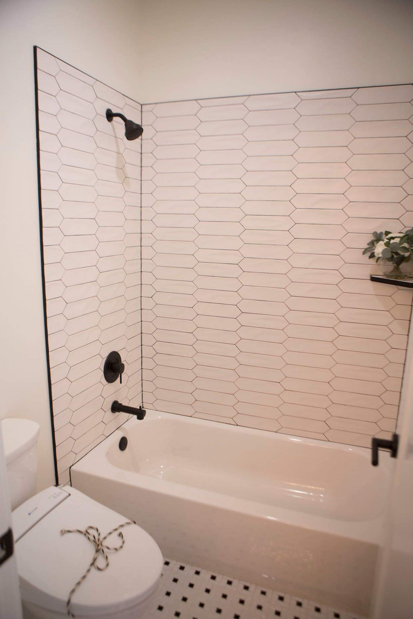 View of all white shower