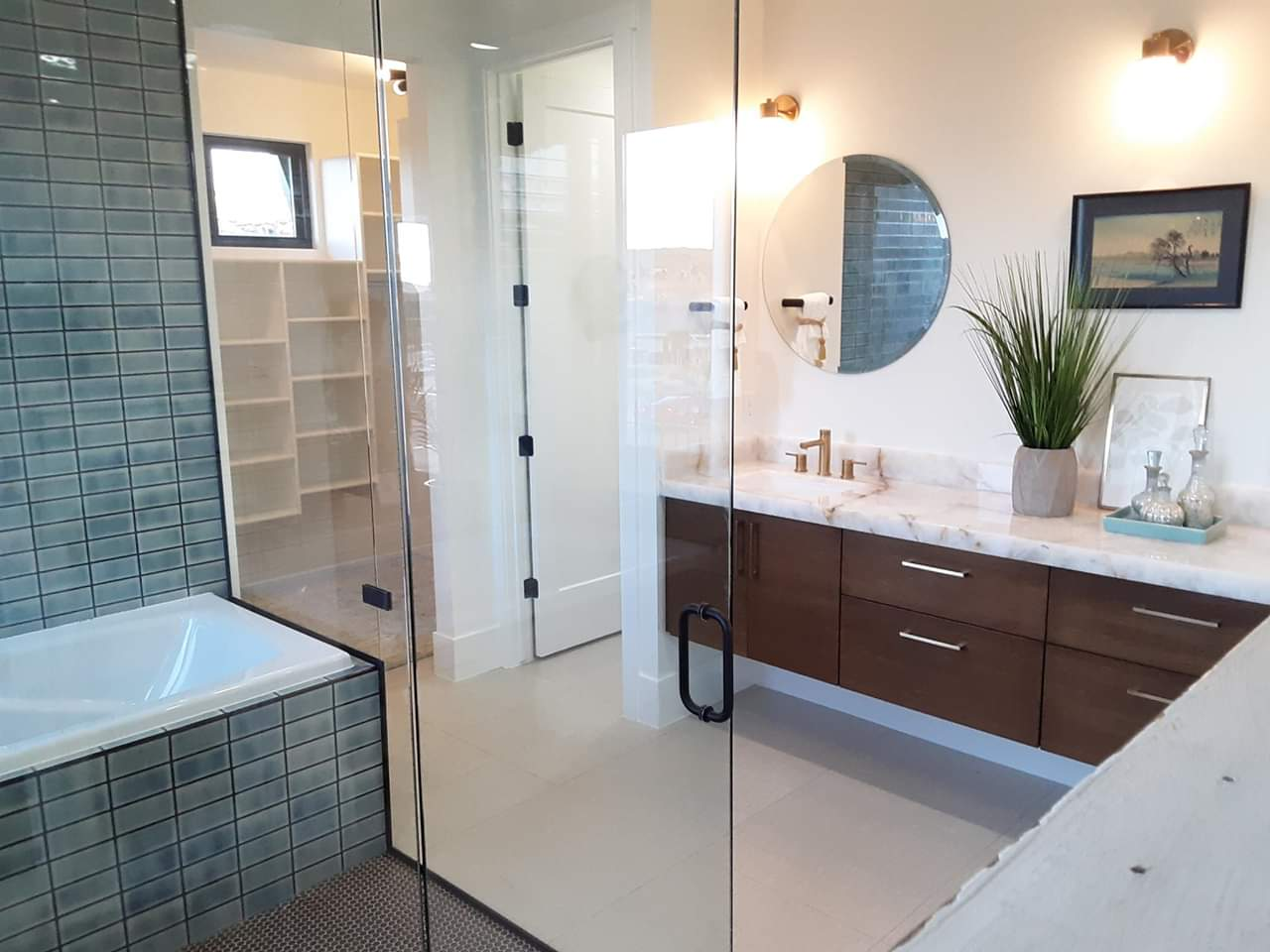 View of modern bathroom, shower, and closet